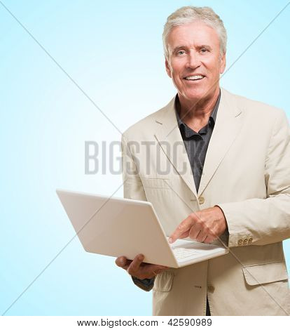 Businessman Holding A Laptop against a blue background