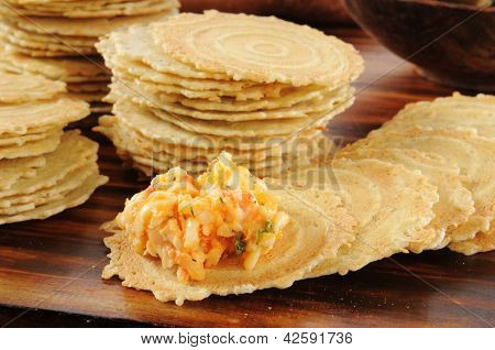 Gouda And Pimento Cheese Spread On Crackers