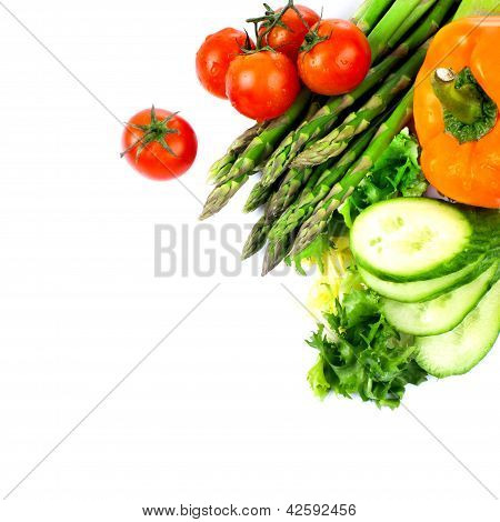 Tomatoes And Green Leaves Isolated On White Background