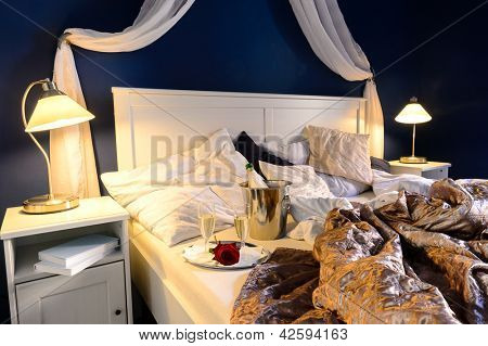 Rumpled sheets luxury hotel bedroom romantic night unmade bed
