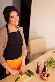 picture of pinafore  - Beautiful young smiling woman cooking healthy salad at home - JPG