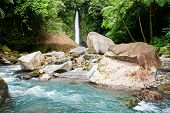 stock photo of camiguin  - Tropical waterfall in forest - JPG