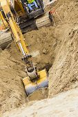 stock photo of backhoe  - Working Excavator Tractor Digging A Trench - JPG