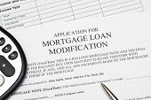 stock photo of modification  - Application for mortgage loan modification with pen - JPG
