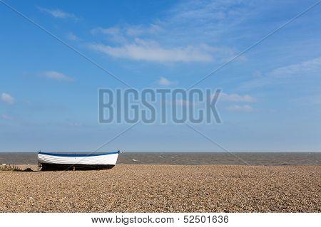 Old Fishing Boat On Pebble Beach