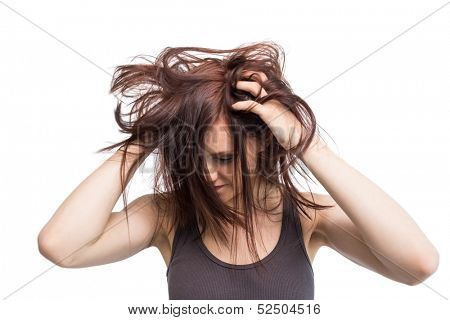 Pretty young brunette on white background moving her hair