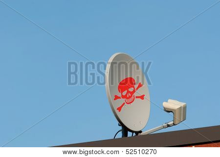 Dish Antenna With Red Skull Sign On A Roof