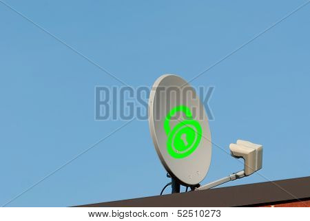 Dish Antenna With Locked Sign On A Roof