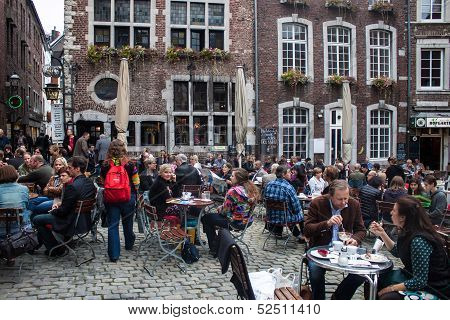 People sit in cafes in Aachen