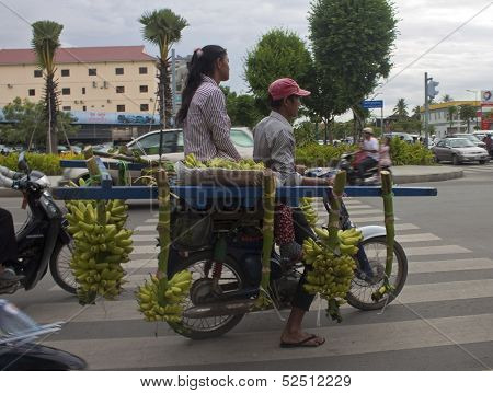 Banana carrier on a street in Pnom Penh