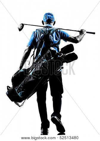 one man golfer golfing golf bag walking  in silhouette studio isolated on white background