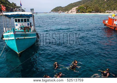 Boats and scuba divers