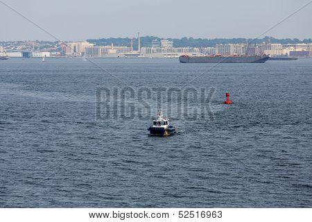 Police Boat Cruising Past Red Channel Marker