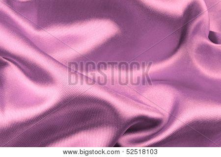 Pink wavy silk fabric .