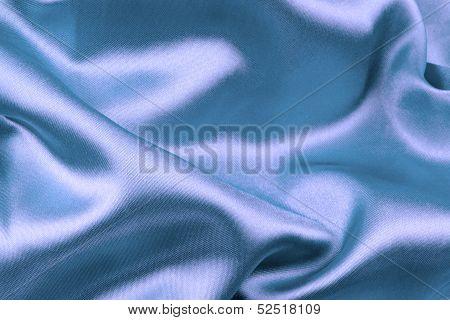 Purple wavy silk fabric .