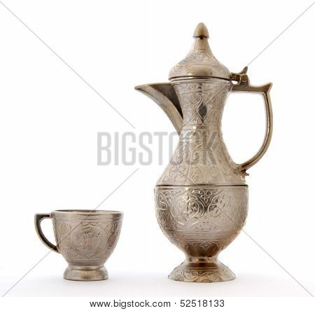 Turkish ottoman style metal pitcher and metal cup.