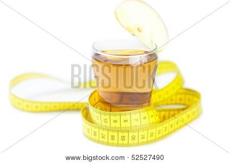 Measuring Tape,apples And Glass Of Apple Juice Isolated On White