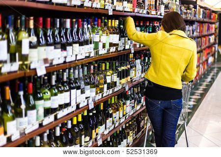 BEIJING,CHINA - MAR 23: Hualian supermarket shelves with wine on March 23th 2013 in Beijing. Hualian is China's first supermarket chains listed companies.