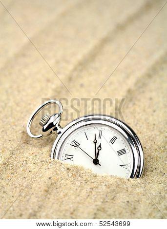 Pocket watch semi buried .