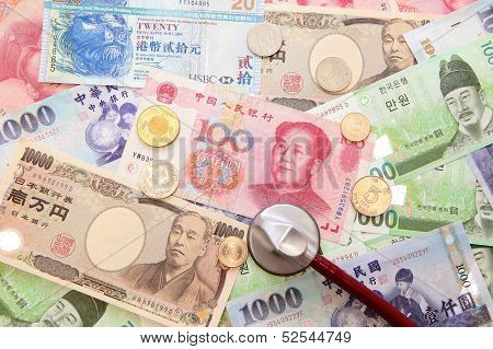 Asian Currency, Stethoscope And Background Of Asian Currency
