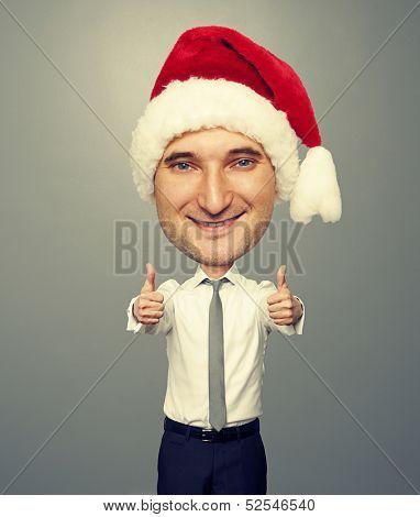 bighead santa man showing thumbs up and smiling