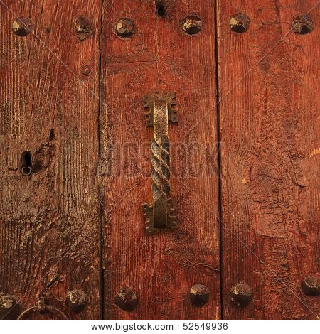 Varnished Wooden Door With Antique Doorhandle