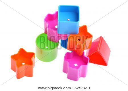 Various Coloured Blocks For Shape Sorter Toy Isolated On White. Copy Space And Room For Text Availab