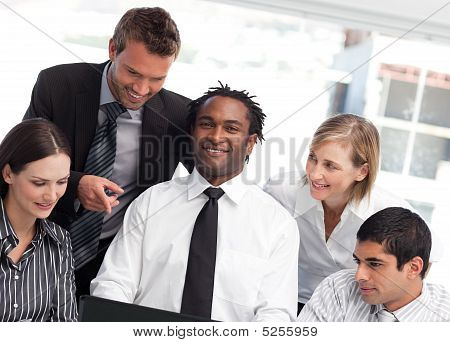 Multi-ethnic Business Team Together In An Office
