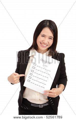 Business woman smilingly take check item paper