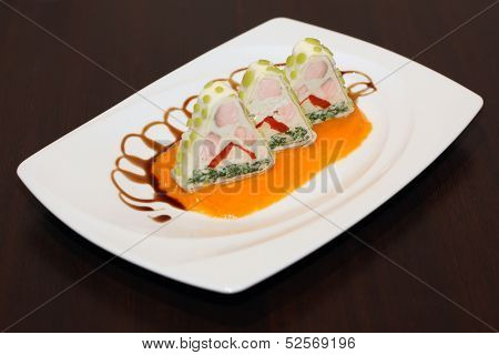 Ornated food served on white plate