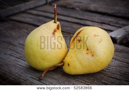 Homegrown pears on wooden background