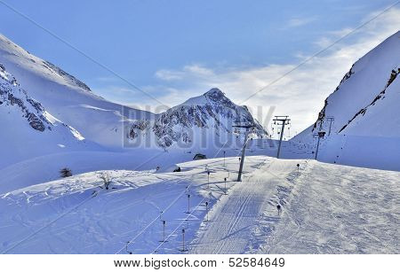 Ski Lift In Alps At Sunset