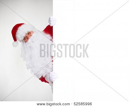 Happy Santa Claus with christmas blank banner.  Isolated on white background.