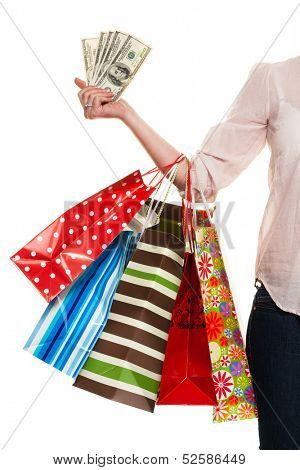 a young woman with colorful shopping bags while shopping. with dollar banknotes