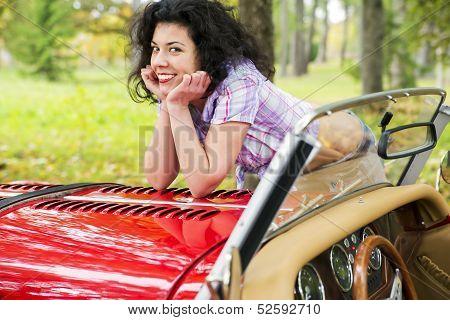Woman Relay Elbows On Retro Car Cowling