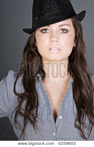 Shot Of A Stunning Brunette Teenager With Black Hat
