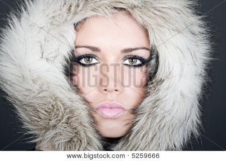 Striking Headshot Of A Beautiful Teen In Fur Lined Hood