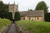 foto of slaughter  - St Peters parish church in Upper Slaughter in Cotswold or Cotswolds district of southern England in the autumn - JPG