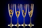 stock photo of beaker  - four glass goblet for champagne with numeral 2014 beautiful celebrations New Year concept photo - JPG