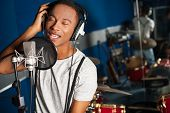 stock photo of singer  - Young male singer in a recording studio - JPG
