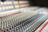 stock photo of mixer  - Large music mixer desk in recording studio - JPG