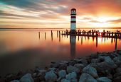 image of lighthouse  - Landscape ocean sunset - lighthouse with sun