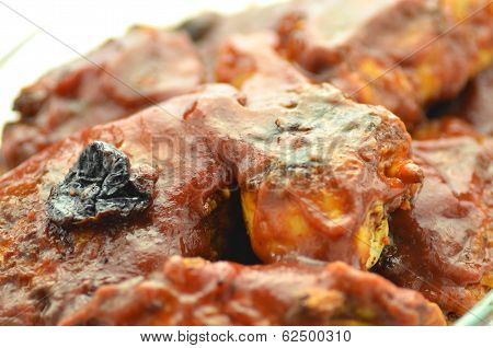 baked chicken in plum sauce isolated on white
