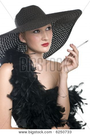 Women In Black Hat And Boa With A Cigarette
