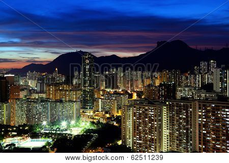 Kowloon cityscape in Kong Kong with lion rock mountain