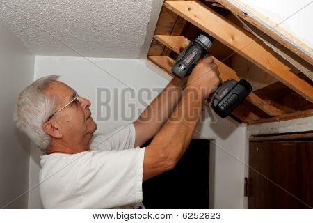 Senior man fixing stairs