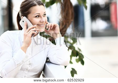 Candid image of a businesswoman working in a cafe