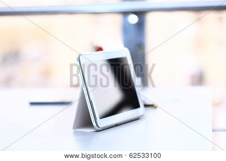 white tablet with a blank screen on table