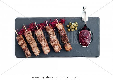 Skewered beef (yakitori) with sauce isolated on white