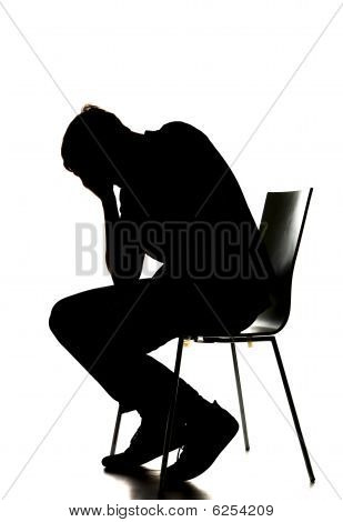 silhouette of a sad man